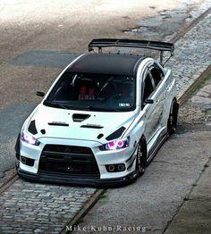 This! Evo X wicked white. Custom headlights