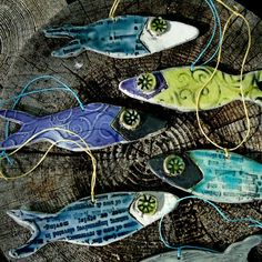 love these ornies! #fish, #clay, #pottery, #ornaments