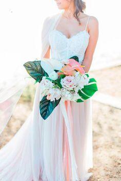Tropical blush and cream bridal bouquet with palm leaves, laceleaf, and orchids. Floral Wedding, Wedding Flowers, Cricut Wedding, Bride Bouquets, Bridal Dresses, Wedding Inspiration, Wedding Ideas, Hawaii Wedding, Bali Wedding