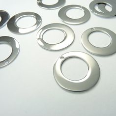 10 Metal Stamping Parts. Stainless Steel Shiny Donut Washers on Etsy, Washer Crafts, Metal Jewelry, Unique Jewelry, Washers, Metal Stamping, Jewelry Making Supplies, Washer Necklace, Pendants, Necklaces