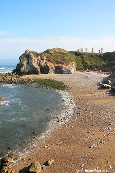 El Cuerno beach seen from the Arnao tunnel in Salinas, Asturias, Spain. Love the hills surrounding it!