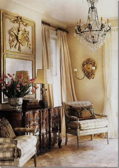 n this vignette, Gerrie Bremermann uses a combination of a crystal chandelier, sconces, and lamps to light this living room.