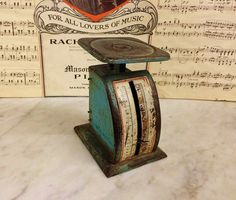 Where can you buy a VINTAGE GREEN KILO POSTAL SCALE? Here and this rough n tumbled scale has been through the WRINGER! Lotsa personality on this one. Itd be great for a photo shoot, nestled amongst your books or just sittin pretty in your kitchen. It has lots of wear on the original green paint which has faded in places to a soft turquoise. https://www.etsy.com/listing/492927305 $25.00.