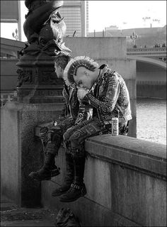 Two male punks sitting on a wall, smoking, in UK. I wonder how they look today? I remember being quite scared of punks yet dressing like them as a means of standing apart from my parents...well at least while I was in England anyway!