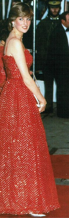Lady Diana Spencer attends the Premiere of the new James Bond movie 'For Your Eyes Only' - June 24th 1981. Diana looked stunning wearing a vibrant red and gold chiffon evening gown studded with sequins, designed by Bellville Sassoon.