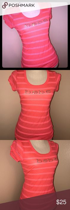 Bebe top New with tags, size Small, 59% polyester 40% rayon 1% spandex hot pink-ish mango color bebe Tops