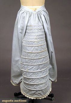 Lobster Tail Bustle, circa 1870s, gingham cotton edged in Broiderie Anglaise lace. Via Augusta Auctions.
