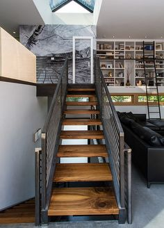 Industrial-styled mezzanine with wooden staircase and metal railing