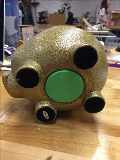 Piggy bank plug designed on Onshape, 3D printed using Makerbot Replicator. Great problem solving/ engineering activity for students.