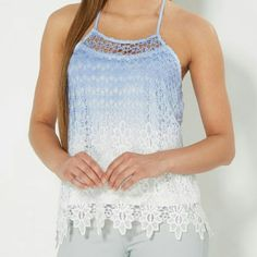Dip Dyed Crochet Tank Top Revamp your warm weather wardrobe with this stylish tank top! It's designed with crochet medallions that lead to floral at the hemline. Dip dyed blue and finished with a ruched back. Rue 21 Tops Crop Tops