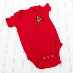 Star Trek onesie...but its a red shirt! *snickers* geekery