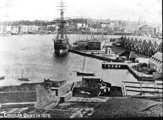Campbells Wharf at Sydney Cove in 1878.The wool stores are at the eastern side of Circular Quay, the Commissariate Building at right rear and Campbells' Wharf together with Campbells Crane.The guns of Dawes Battery are in the foreground. •City of Sydney Archives•