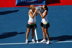 Sara Errani (ITA)[2] and Roberta Vinci(ITA)[2] kiss the trophy after winning  the Women's Doubles Final against Andrea Hlavackova (CZE)[3] and  Lucie Hradecka(CZE)[3]  at the 2012 US Open. - Philip Hall/USTA