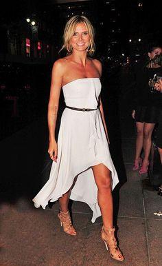 Heidi Klum looks happy as she arrives at the Four Seasons restaurant in New York.
