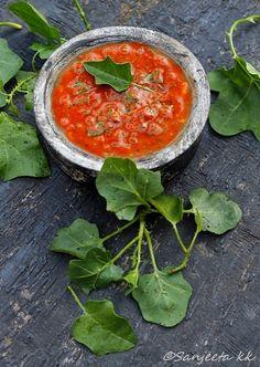 Purple fruited pea egg plant and tomato curry aka Thuthuvali-tomato Kuzhambu