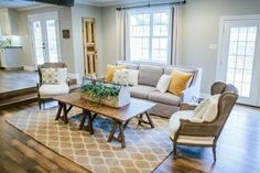 Wide plank floors and lots of natural light.. Soft color decorating. Joanna from fixer upper is amazing!