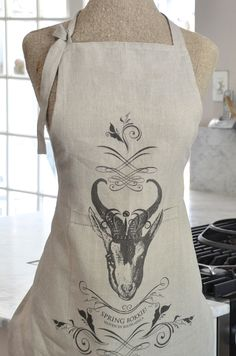 A linen apron printed with a hand drawn tongue-in-cheek design of South Africa's favourite buck.  Manufactured in India and imported by Masquerade Printed in South Africa Made from 100% linen, woven from Belgium linen flax Designed by and exclusive to Masquerade