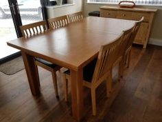 Customer photo 1 - Country oak large double extending dining table in a customers dining room next to a sideboard.