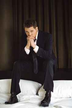 Micheal Buble. After a long days work I'd definitely love to come home to him sitting on my bed just like that LOL....waiting for me :)