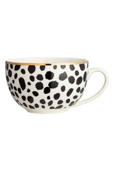 Leopard-print cup: Leopard-print porcelain cup with a gold-coloured rim and text print inside. Height 7.5 cm, diameter at the top 11.5 cm.
