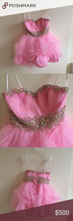 Pink puffy short prom dress So if anyone happens to be graduating this year, here's a beautiful prom dress for ya. Very princess like and puffy. Gorgeous little gems embedded into the waist. The shade of pink is beautiful as well. Looks extremely flattering. It's a large but since the back is adjustable, it can fit a medium as well. The price reflects the great quality. It's not a cheap dress that's going to feel uncomfortable. Willing to accept offers but no low balls Dresses Prom