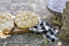 Amazing looking bread. Wooden slab. Gingham towel. Surrounded by stone. Yes please, to all of the above.