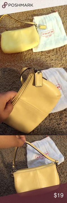 Small Yellow Coach wristlet Only used once no original tag. coach wristlet with coach pouch. Coach Bags Clutches & Wristlets