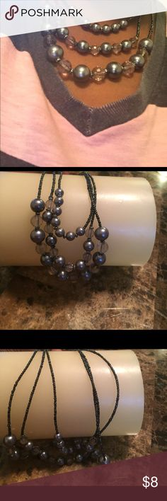 Three strand gray and clear beaded necklace. Three strand gray and clear beaded necklace. Beautiful piece. Elegant and classy. Jewelry Necklaces