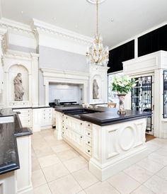 Clive Christian architectural kitchen in antique ivory looking towards mantle