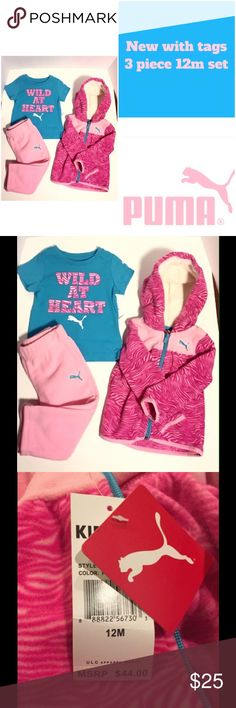 NWT 3 piece Puma girls set 12m New with tags! 3 piece set size 12m. 1st piece: Wild at heart short sleeve blue shirt. 60% cotton and 40% polyester. Piece 2: pink patterned fleece zip up hoodie. Soft hoodie lining. 3rd piece pink fleece pants. 2nd and 3rd item 100% polyester. Puma Matching Sets