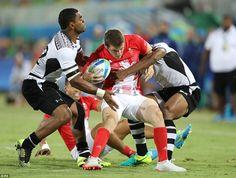 Fiji's Vatemo Ravouvou (left) challenges Great Britain's Mark Bennett during the Rugby Sevens Men's Gold Medal Match