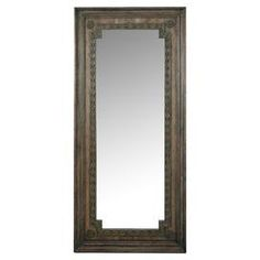 """An elegant addition to your master suite or walk-in closet, this stunning floor mirror showcases intricately carved moldings and corner medallions.  Product: Floor mirrorConstruction Material: Wood and mirrored glassColor: BrownFeatures:  Carved moldingsCorner medallionsBeveled mirror Dimensions: 82"""" H x 38"""" W x 2"""" D"""