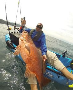 Kayak catch of a lifetime!  Keeton's man-sized snapper that did not get away. (This shot also reinforces the inherent stability of Hobie's Outback.)