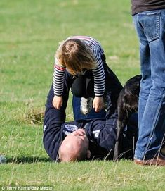 Doting father Mike Tindall was spotted frolicking with his adorable three-year-old daughter as they supported his British equestrian wife, in Lincolnshire yesterday afternoon. Mike Tindall, House Of Windsor, Visit Canada, Princess Anne, Three Year Olds, Candid Photography, Second Child, Royal Families, British Royals
