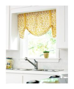 possible idea for kitchen curtains over sink- style... prob diff color, but like the light/bright look