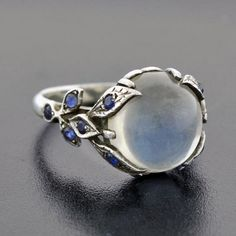 A Brandt and Son - Vintage Sterling Moonstone Cabochon & Sapphire Ring