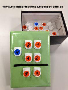 Caja con tapones para sumas y restas