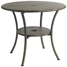 Patio Table that holds an umbrella . . . may need to take a look at this : )