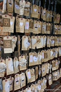 shipping tags-brillant idea for clips and bows!  Punch a hole and wall-ah!
