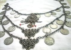 A Yazidi Kurdish necklace in silver with filigree, granulation, coins and chains.  From northern Iraq.