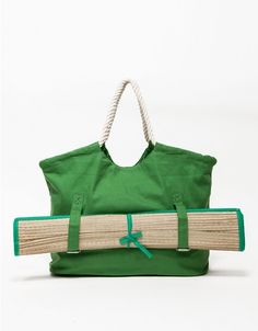 Classic canvas summertime beach tote with a role up beach mat. Features snap closure, full lining, soft rope handles, and two interior pockets. Canvas beach tote Soft rope handles Fully lined Rolled up beach matt with straps Yoga Mat Bag, Diy Purse, Beach Tote Bags, Fabric Bags, Summer Bags, Cloth Bags, Handmade Bags, Purses And Bags, Beach Mat