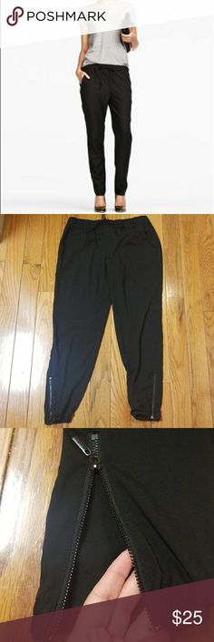 Bisou Bisou Dressy Black Joggers Bisou Bisou Dressy Black Joggers with pockets and zippers down the bottom near the ankle. Have a drawstring waist. Perfect with heels or dressy sandals😍  Great condition,  used a handful of times   Size Large  Come from smoke and pet free home 🚫 Bisou Bisou Pants