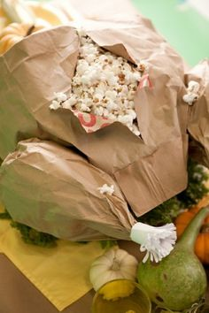 """Thanksgiving Feast appetizer (or kid table decor): paper bag """"turkey"""" filled with popcorn."""