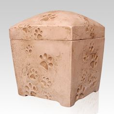 The Forever Dog Print Urn is made from high quality, sturdy poly-stone but amazingly has the look of ceramic. The piece's picture frame feature allows for personalization that will keep memories of your beloved pet alive for a lifetime.