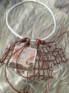 Check out the latest.... Metallic silver leather collar with recycled acrylic slices  http://www.phyllisclark.com/new-products/metallic-silver-leather-collar-with-recycled-acrylic-slices  #jewelry #contemporary #phyllisclark