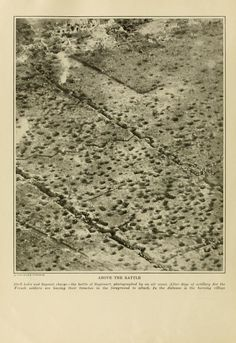 """"""" Above the Battle. Shell holes and bayonet charge- the battle of Soyecourt, photographed by an air scout. After days of artillery fire the French soldiers are leaving their trenches in the foreground to attack. In the distance is the burning village""""."""