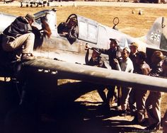 A Sgt. adds another miniature to those on side of a Curtiss P-40 of the 26th Fighter Sqd., 51st Fighter Group. China