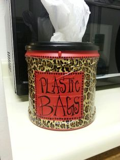 Old coffee container, fun duck tape and a Sharpie. Plastic Bag despenser!