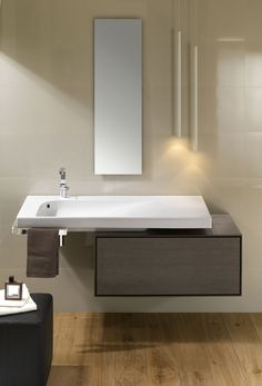 Grandagolo wall basin with matching towel bar and cabinetry