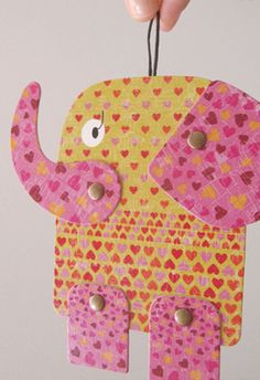 Dante Elephant.  Can be moved as many times as you want. Play with it, hang it up, frame it. Characteristics: Images printed on cardboard. It measures approximately 12cm.